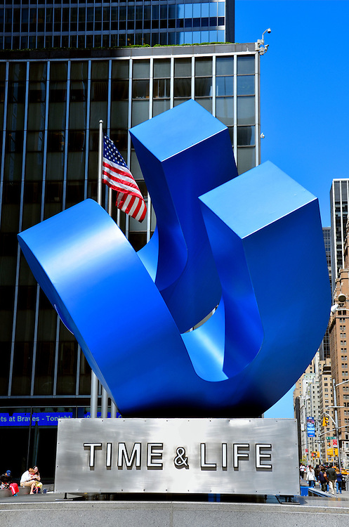 Time-Life Building Cubed Curve Sculpture in New York City, New York<br /> This giant, blue sculpture outside the entrance of the Time-Life Building on the Avenue of the Americas is called Cubed Curve.  It was created in 1972 by William Crovello and sponsored by the Association for a Better New York.  Time Inc. occupies 21 of the 48 floors but announced in 2014 their plans to move out soon.  Perhaps that will leave extra room for the expansion of the fictional advertising agency Sterling Cooper Draper and Pryce from the Mad Men TV show.