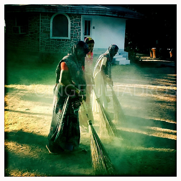 Women sweeping the grass