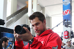 May 29; Newark, NJ, USA; New Jersey Devils right wing Dainius Zubrus (8) plays photographer during Stanley Cup Finals media practice day at the Prudential Center.