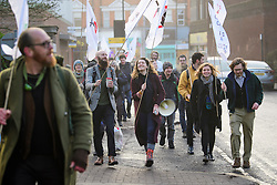 © Licensed to London News Pictures. 22/12/2016. London, UK. A group of accused Heathrow protestors and their supporters arrive at Ealing Magistrates Court in London. 15 protestors are charged with Wilful Obstruction of the Highway after blocking an access road to Heathrow on November 18, 2016. Photo credit: Ben Cawthra/LNP