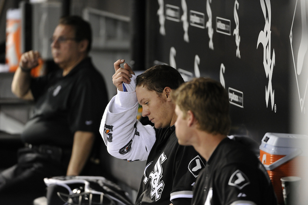 CHICAGO - MAY 03:  Jake Peavy #44 of the Chicago White Sox wipes his forhead during the game against the Kansas City Royals on May 03, 2010 at U.S. Cellular Field in Chicago, Illinois.  The White Sox defeated the Royals 5-1.  (Photo by Ron Vesely)