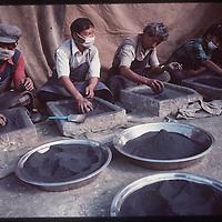 photo by David Stephenson.  Grinding Tibetan herbal medicine in Dharamsala, India, in 11/91.