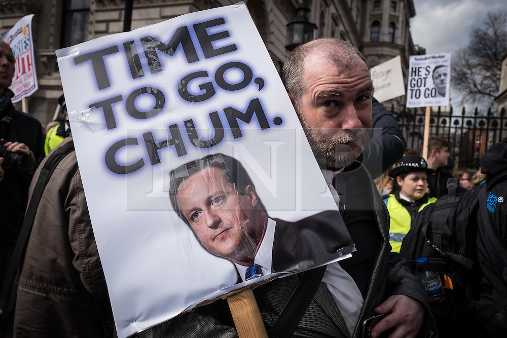 © Licensed to London News Pictures. 09/04/2016. London, UK. Outside Downing Street, a protester calls for the resignation of British Prime Minister David Cameron after he admitted to profiting from the sale of shares worth more than £30,000 in Blairmore Holdings, an offshore investment fund set up by his late father Ian Cameron. The Panama Papers, leaked anonymously from the database of law firm Mossack Fonseca, have revealed the extent to which firms and wealthy individuals use loopholes and offshore funds to avoid paying tax. Photo credit: Rob Pinney/LNP