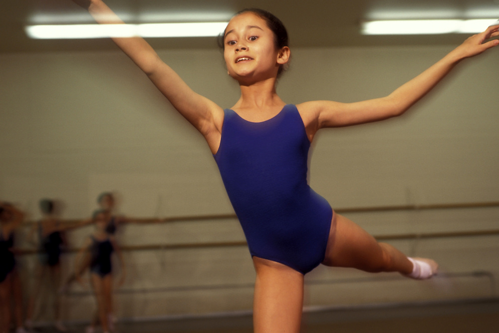 Canada, Ontario, Toronto, Young girl practices in windowless dance studio at the National Ballet School