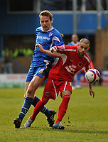 Photo: Tony Oudot/Richard Lane Photography. <br /> Gillingham Town v Carlisle United. Coca-Cola League One. 21/03/2008. <br /> Simon Hackney of Carlisle beats Mark Bentley of Gillingham to the ball