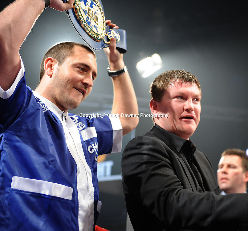 Promoter Ricky Hatton and actor Will Mellor holding Stephen Foster Jnr's belt before his fight with Ermano Fegatilli at The Night of Champions, Premier Suite,Reebok Stadium, Bolton,UK. Saturday 26th February 2011. Hatton Promotions. Photo credit © Leigh Dawney.