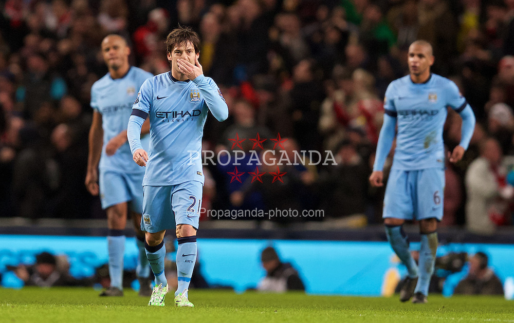 MANCHESTER, ENGLAND - Sunday, January 18, 2015: Manchester City's David Silva looks dejected as Arsenal score the second goal during the Premier League match at the City of Manchester Stadium. (Pic by David Rawcliffe/Propaganda)