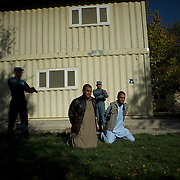 Afghan National Police (ANP) cadets simulate the arrest of Talibans during combat exercises at the Afghan Nacional Police Academy in Kabul.