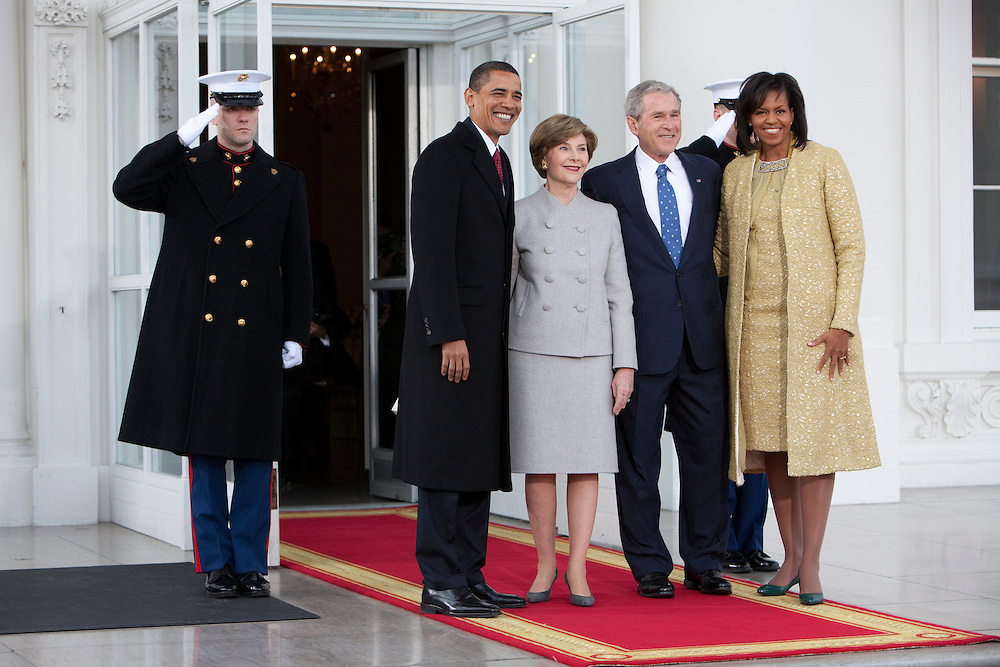 WASHINGTON - JANUARY 20: President George W. Bush and First Lady Laura Bush greet President-elect Barack Obama and Michelle Obama at the North Portico of the White House, where the two families will have coffee together, on January 20, 2009 in Washington, DC. President-elect Barack Obama will be sworn in as the country' 44th president at noon today. (Photo by Brendan Hoffman/Getty Images) *** George W. Bush;Laura Bush;Barack Obama;Michelle Obama