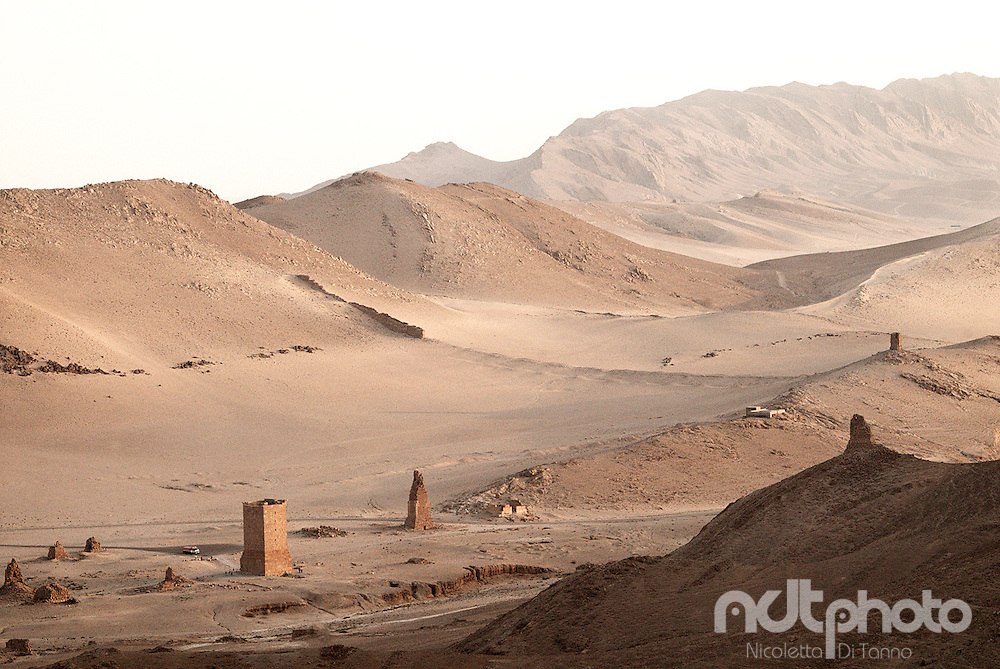 Ruins of tombs emerge from the desert in Palmyra, Syria. Palmyra is among the UNESCO world heritage sites.