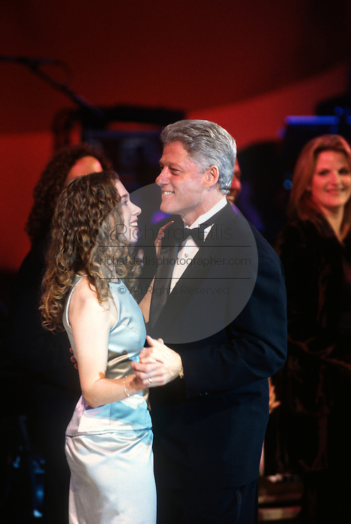 US President Bill Clinton dances with daughter Chelsea at an inaugural ball for the 2nd Inauguration of President Bill Clinton January 20, 1997 in Washington, DC.