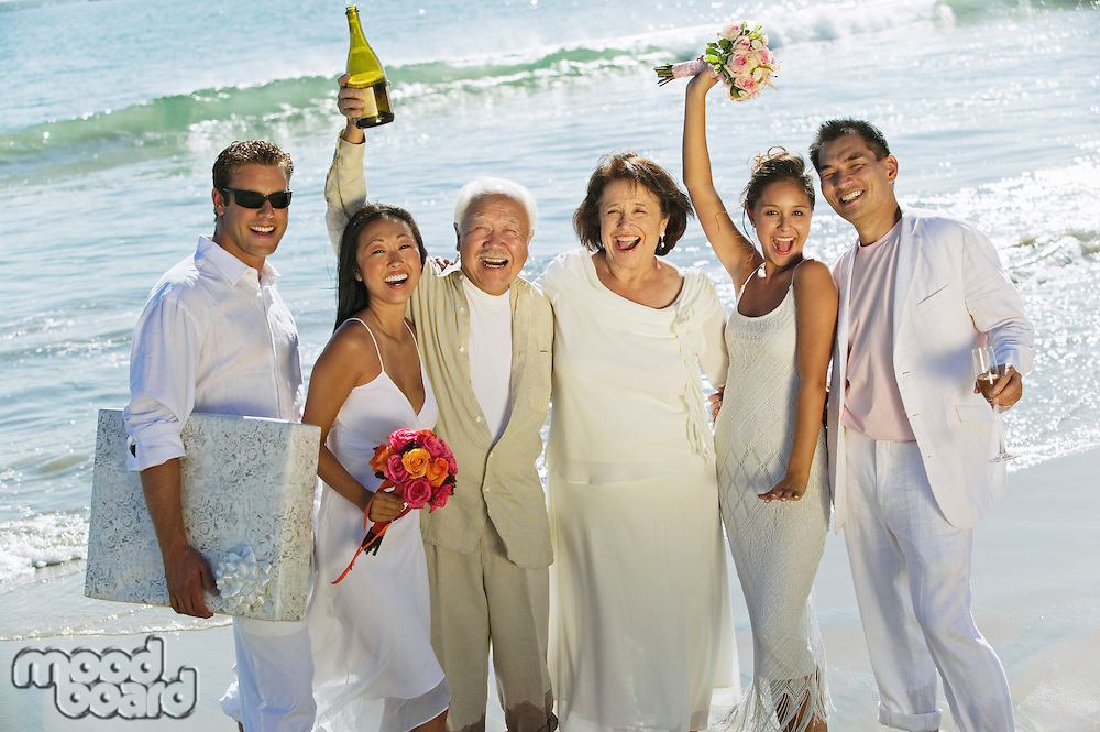 Family celebrating wedding on beach
