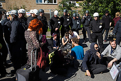 Bailiffs monitor housing activists evicted from properties on the Sweets Way housing estate on 23rd September 2015 in London, United Kingdom. A group of housing activists calling for better social housing provision in London had occupied some of the properties on the 142-home estate in Whetstone, in some cases refurbishing properties intentionally destroyed by the legal owners following eviction of the original residents, in order to try to prevent the eviction of the last resident on the estate and the planned demolition and redevelopment of the entire estate by Barnet Council and Annington Property Ltd.