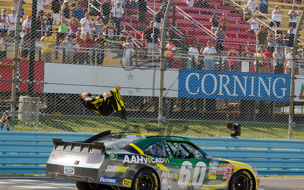 WATKINS GLEN, NY - AUG 11, 2012:  Carl Edwards (60) holds off the rest of the field to win the Zippo 200 race at Watkins Glen International in Watkins Glen International, NY.