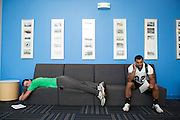 09/19/2014 - Medford, Mass. - Tufts RB Chance Brady, A17, right, and Tufts WR Jack Cooleen, A16, wait for a team meeting to start in preparation of their season opener against Hamilton on Sept. 19, 2014. (Kelvin Ma/Tufts University)