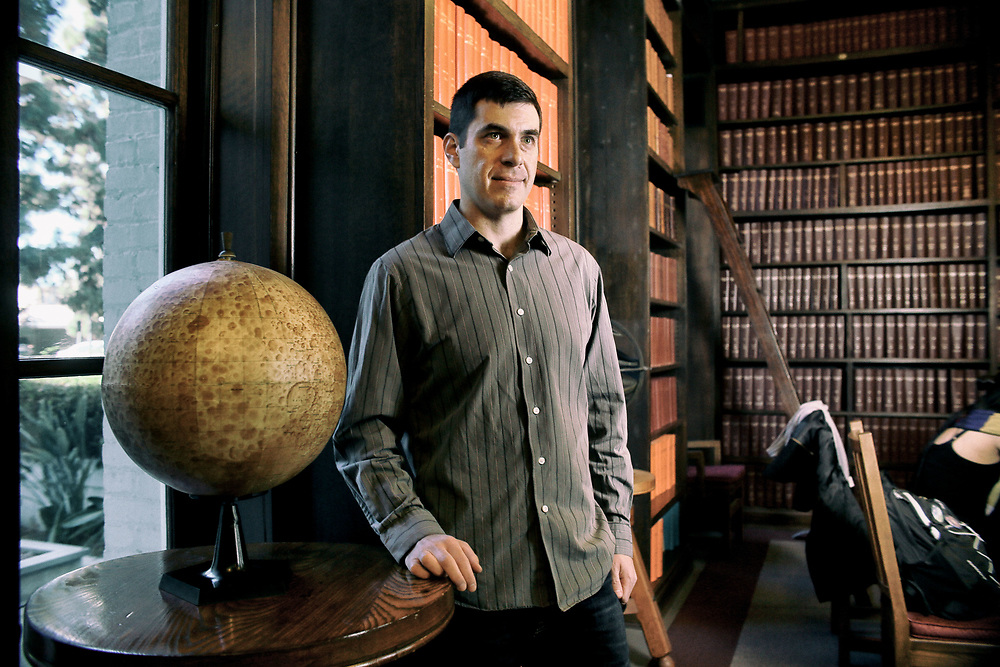 Ligo Scientist Josh Simon stands in the library at the Carnegie Institute in Pasadena, CA on Tuesday, December 12, 2017.(Photo by Sandy Huffaker)