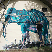 London,England,UK : 10th April 2016 : Andy Council street artists paint a live Elephant for the 'Endangered 13' at Ackroyd Drive Sponsor by Tower Hamlets council in London. Photo by See Li