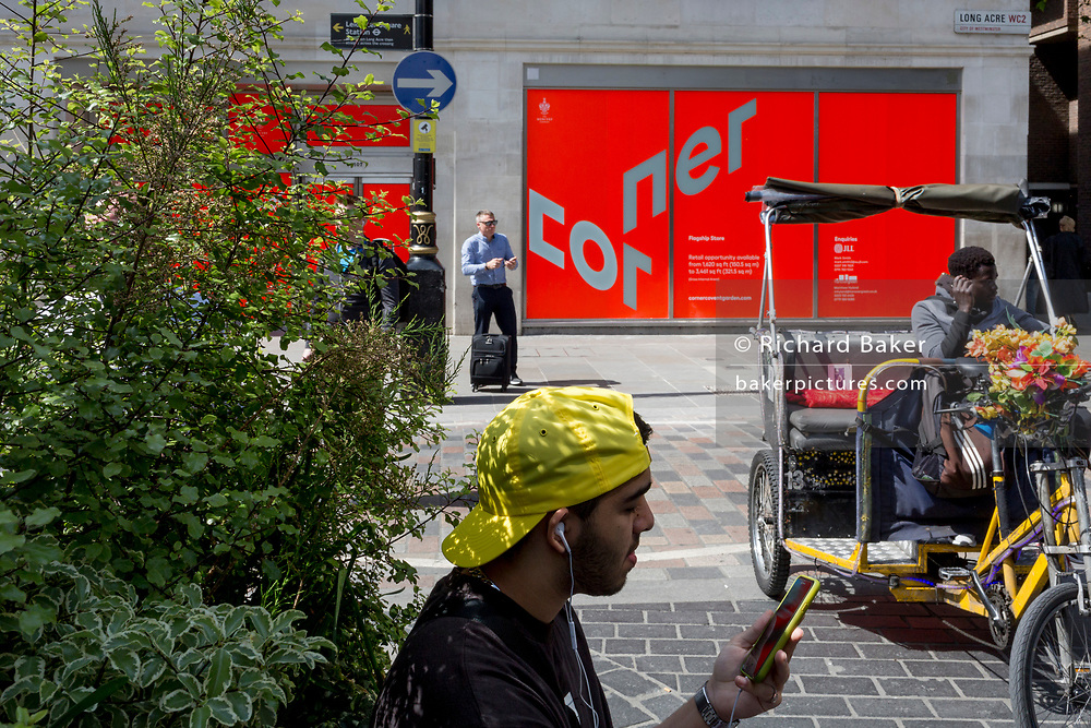 Passers-by and Londoners on the corner of Covent Garden and Acre Lane in the West End, on 22nd May 2019, in London, England