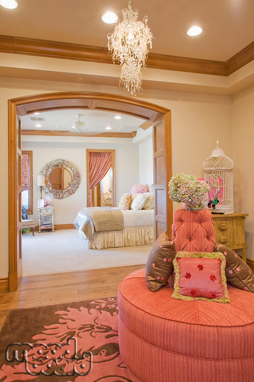 Looking into a bedroom interior from adjoining room