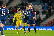 Greg Taylor (#3) of Scotland gets to the ball ahead of Abat Aymbetov (#17) of Kazakhstan during the UEFA European 2020 Group I qualifier match between Scotland and Kazakhstan at Hampden Park, Glasgow, United Kingdom on 19 November 2019.