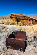 Ore car and the Bodie Jail, Bodie State Historic Park, California USA