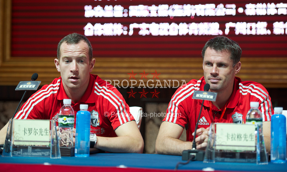 GUANGZHOU, CHINA - Monday, July 11, 2011: Liverpool's Carlie Adam and Jamie Carragher during a press conference at the Chateau Star River Hai Yi Peninsula during the club's Asia Tour. (Photo by David Rawcliffe/Propaganda)