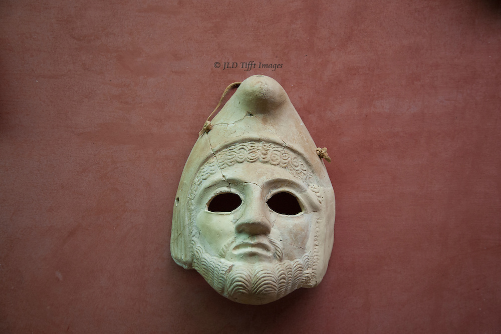 Blank eyed theatrical mask on display in the Museo Nacional de Arte Romano, Merida, Spain.  It wears a Phrygian cap, which in the western provinces of the Roman Empire came to signify freedom and the pursuit of liberty, perhaps through a confusion with the pileus, the felt cap of manumitted (emancipated) slaves of ancient Rome.
