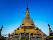 27 OCTOBER 2015 - YANGON, MYANMAR: Botataung Paya (Pagoda) located in downtown Yangon, Myanmar, near the Yangon river. The pagoda was first built by the Mon around the same time as was Shwedagon Pagoda—according to local belief, over 2500 years ago. The paya is hollow within, and houses what is believed to be a sacred hair of Gautama Buddha. The Paya was destroyed during World War II, in Nov 1943 and was rebuilt after Burma achieved independence from Britain.    PHOTO BY JACK KURTZ