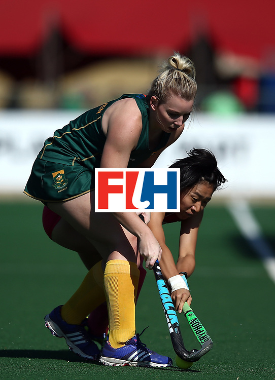 JOHANNESBURG, SOUTH AFRICA - JULY 22:  Nicole Walraven of South Africa battles with Mami Karino during day 8 of the FIH Hockey World League Women's Semi Finals 5th/ 6th place match between Japan and South Africa at Wits University on July 22, 2017 in Johannesburg, South Africa.  (Photo by Jan Kruger/Getty Images for FIH)