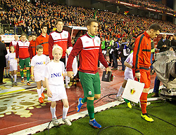 BRUSSELS, BELGIUM - Tuesday, October 15, 2013: Wales' captain Aaron Ramsey walks out to face Belgium before the 2014 FIFA World Cup Brazil Qualifying Group A match at the Koning Boudewijnstadion. (Pic by David Rawcliffe/Propaganda)
