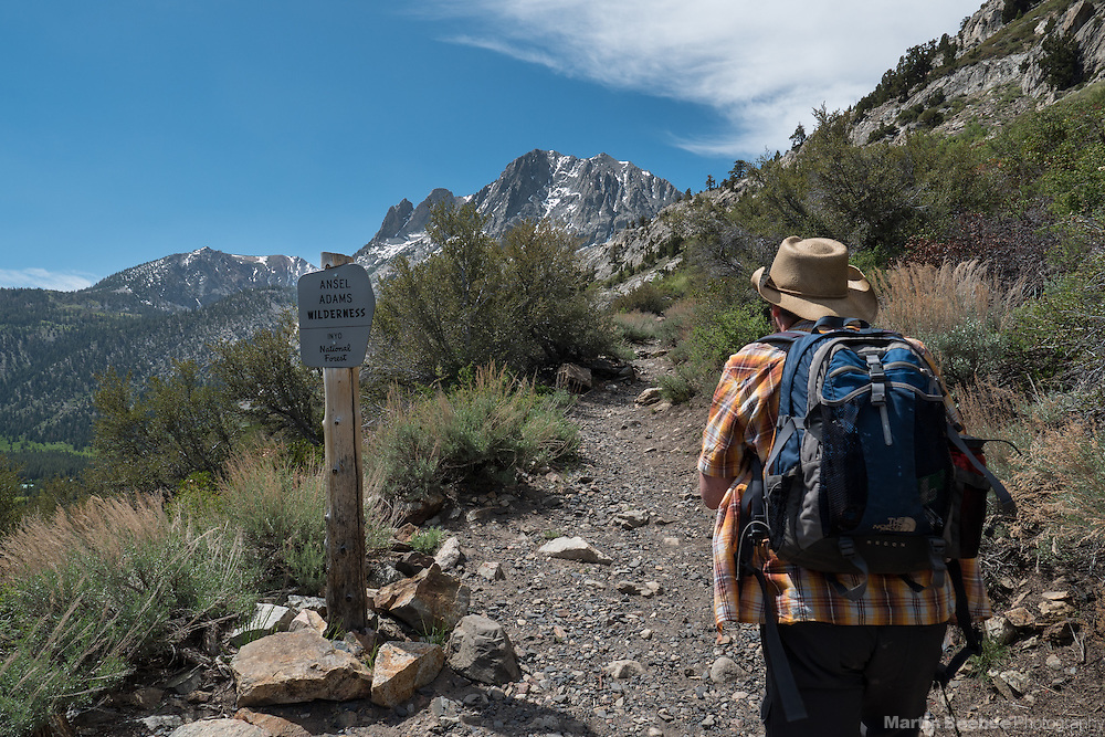 Day hiker entering Ansel Adams Wilderness in the Eastern Sierra Nevada, Inyo National Forest, California