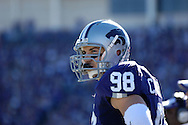 MANHATTAN, KS - NOVEMBER 17:  Linebacker Ian Campbell #98 of the Kansas State Wildcats looks out onto the field before the start of the second half against the Missouri Tigers on November 17, 2007 at Bill Snyder Stadium in Manhattan, Kansas.  Missouri won the game 49-32.  (Photo by Peter Aiken/Getty Images)
