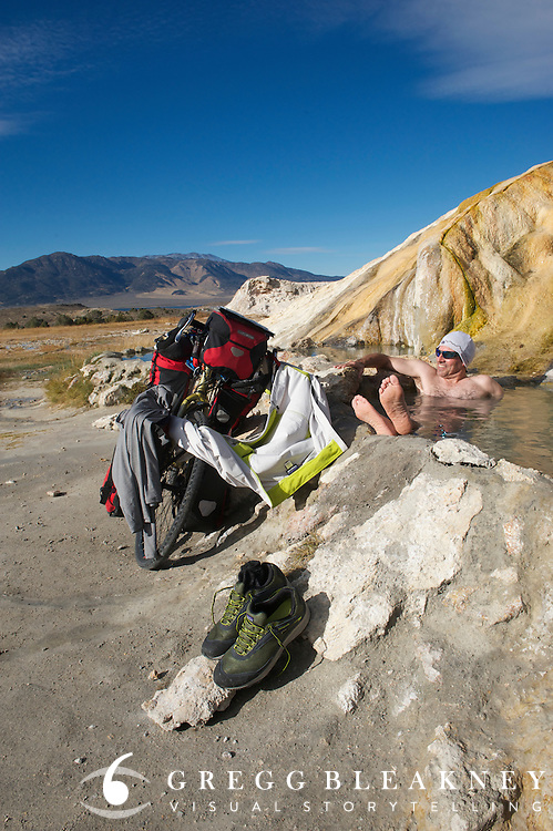 gMack (cyclist) takes a welcomed warm-up dip after two days of cycling through snow storms in the Sierra - Travertine Hot Springs - Bridgeport - CA - Adventure Cycling Sierra Cascades Route - Canada to Mexico Expedition
