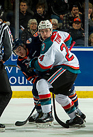 KELOWNA, CANADA - DECEMBER 29:  Josh Pillar #9 of the Kamloops Blazers is checked by Kyle Topping #24 of the Kelowna Rockets after the face off during first period on December 29, 2018 at Prospera Place in Kelowna, British Columbia, Canada.  (Photo by Marissa Baecker/Shoot the Breeze)