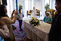 March 23, 2014 - Singapore. Sulastri during her wedding with Mohd. Intially a migrant worker to Singapore, Sulastri worked as a domestic helper with her employer for many years before getting married to her boss. © Nicolas Axelrod / Ruom
