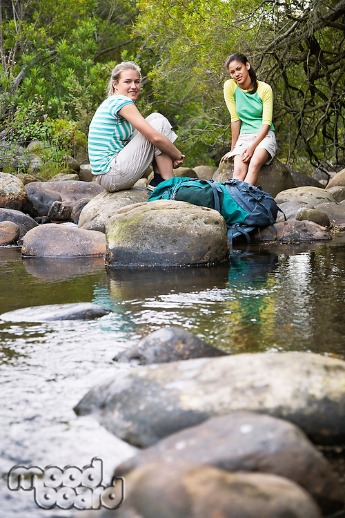 Young Hikers Resting by Creek