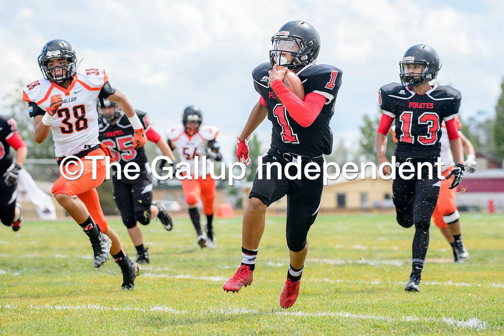 Grants Pirate T.J. Hocker (1) rushes against the Gallup Bengals at Grants High School Saturday.