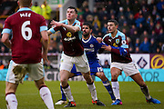 Burnley defender Michael Keane (5) has his eye on the ball watched by Chelsea forward Diego Costa (19)  during the Premier League match between Burnley and Chelsea at Turf Moor, Burnley, England on 12 February 2017. Photo by Simon Davies.