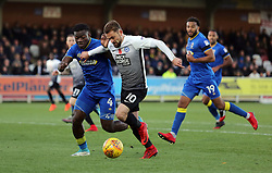 Danny Lloyd of Peterborough United in action with Adedeji Oshilaja of AFC Wimbledon - Mandatory by-line: Joe Dent/JMP - 12/11/2017 - FOOTBALL - Cherry Red Records Stadium - Kingston upon Thames, England - AFC Wimbledon v Peterborough United - Sky Bet League One
