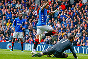 James Tavernier (C) of Rangers FC chips the ball over the advancing Joe Lewis of Aberdeen FC and into the net only to be flagged for offside during the Ladbrokes Scottish Premiership match between Rangers and Aberdeen at Ibrox, Glasgow, Scotland on 27 April 2019.