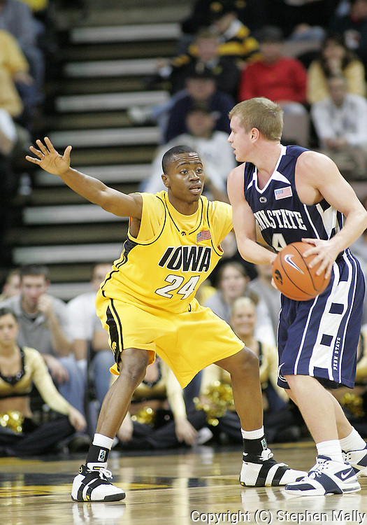 24 JANUARY 2007: Iowa guard Justin Johnson (24) guards Penn State guard Mike Walker (4) in Iowa's 79-63 win over Penn State at Carver-Hawkeye Arena in Iowa City, Iowa on January 24, 2007.