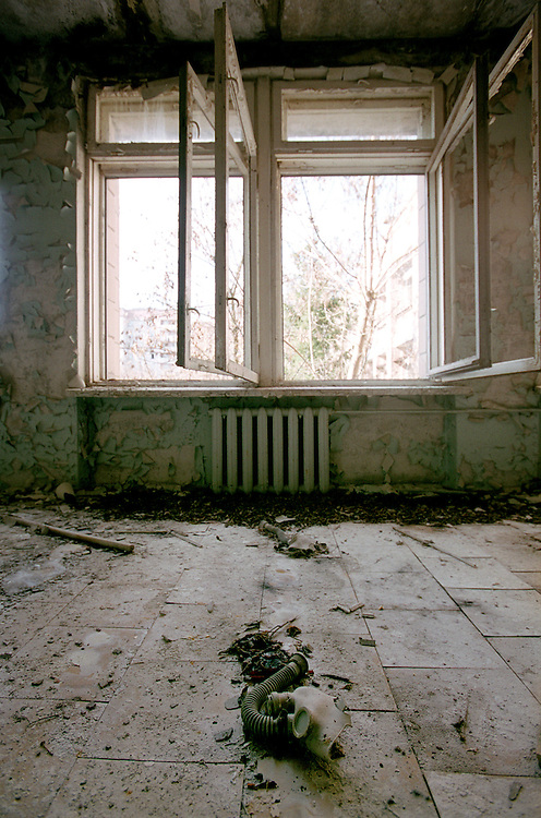 Ukraine 2001...The town of Prypiat close to the power plant. This used to be the city were all the workers in Chernobyl lived. After the accident it was evacuated...A gasmask lies on the floor in a room in a former school...Photo: Markus Marcetic/MOMENT