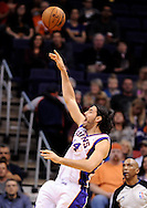 Mar. 1, 2013; Phoenix, AZ, USA; Phoenix Suns forward Luis Scola (14) lays up the ball against the Atlanta Hawks in the first half at US Airways Center. Mandatory Credit: Jennifer Stewart-USA TODAY Sports