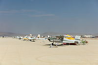 Note the tent behind the first plane. Many burners campout with their planes. My Burning Man 2018 Photos:<br />