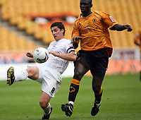 Photo: Rich Eaton.<br /> <br /> Wolverhampton Wanderers v Luton Town. Coca Cola Championship. 26/08/2006. Steve Robinson left of Luton gets the ball ahead of Wolves Seyi Olofinjana
