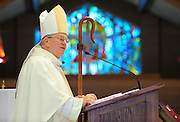 Bishop David Ricken delivers his homily at Mass. (Sam Lucero photo)