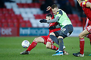 Séamus Conneely of Accrington  and Joe Pigott of Wimbledon contest a loose ball  during the EFL Sky Bet League 1 match between Accrington Stanley and AFC Wimbledon at the Fraser Eagle Stadium, Accrington, England on 1 February 2020.