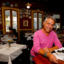 8/14/2013 7:06:40 PM -- New Orleans, LA  -- Cristiano Raffigone owner of Dick & Jenny's restaurant poses at the bar.  Saints rebirth with the return of Head Coach Sean Payton --    Photo by Derick E. Hingle , Gannett