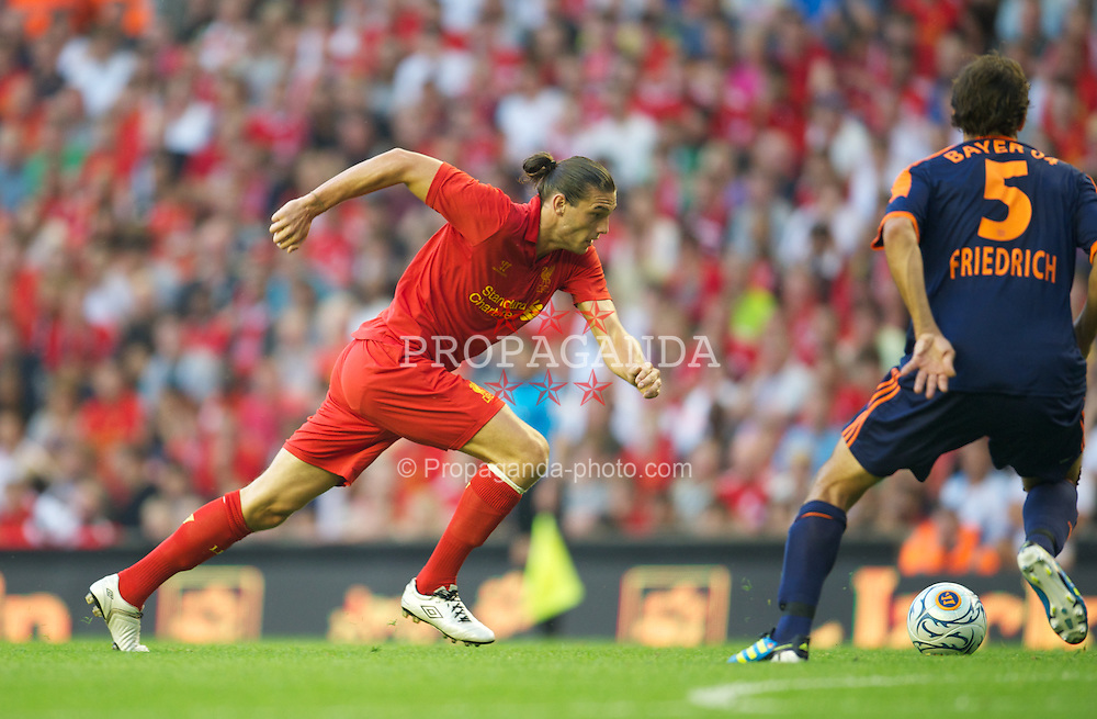 LIVERPOOL, ENGLAND - Sunday, August 12, 2012: Liverpool's Andy Carroll scores the third goal against Bayer 04 Leverkusen during a preseason friendly match at Anfield. (Pic by David Rawcliffe/Propaganda)