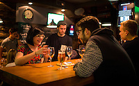 Strasbourg, France - November 14, 2014: Friends gather at Au Fût et à Mesure. The novel bar that allows beer-loving patrons to pour their own via credit cards that can be scanned at a automated taps at every table. CREDIT: Chris Carmichael for the New York Times